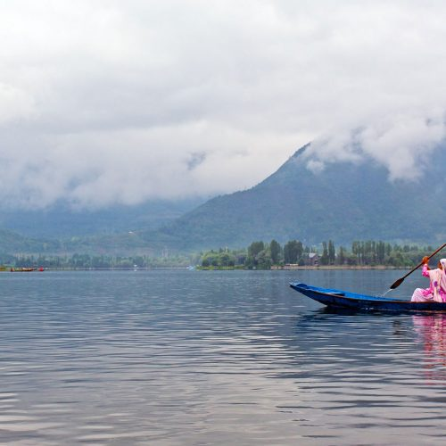 Man in a boat on Dal Lake in Kashmir
