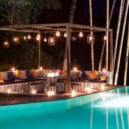 Kandy House outdoor pool lit up at night