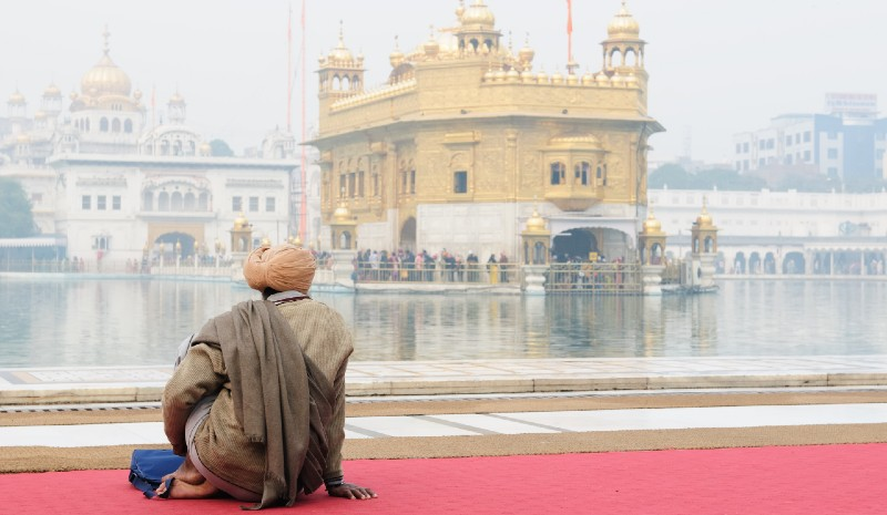 Things to do in Amritsar | Man gazes at Golden Temple